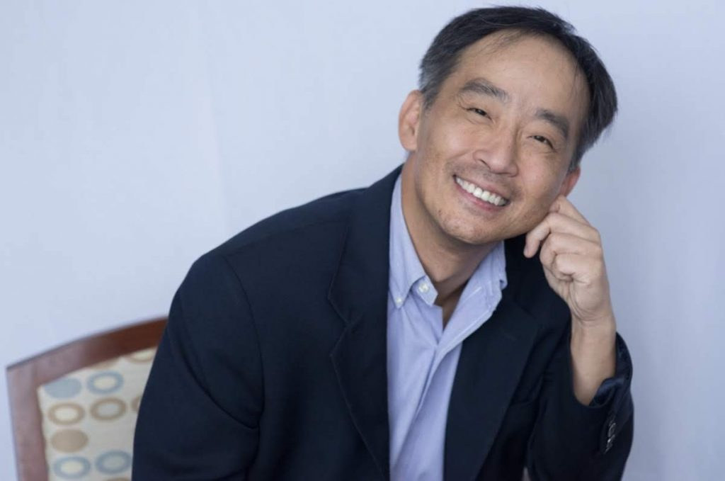 dr. chang smiles and leans in toward the camera
