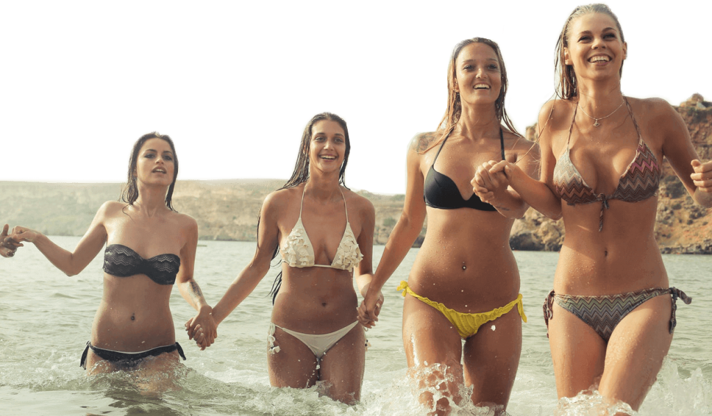 Women wearing bikinis - Most women have uneven breasts
