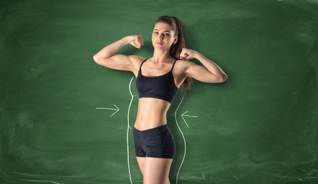 Fitness girl showing her biceps with drawn fat around body
