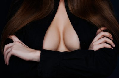 Topless beauty woman body covering her breast