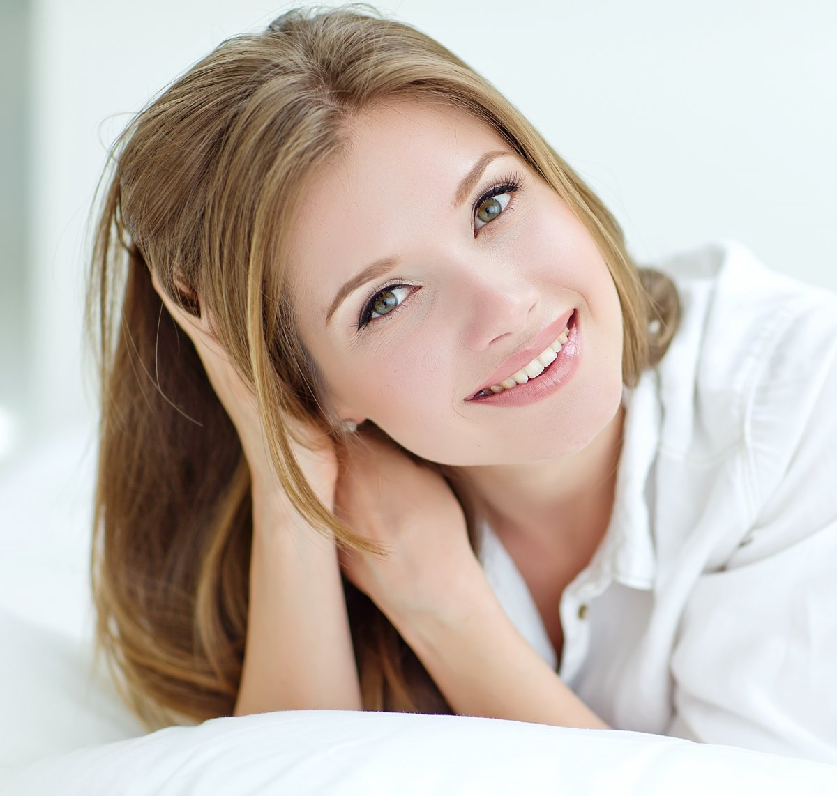 Beautiful woman in the morning bed